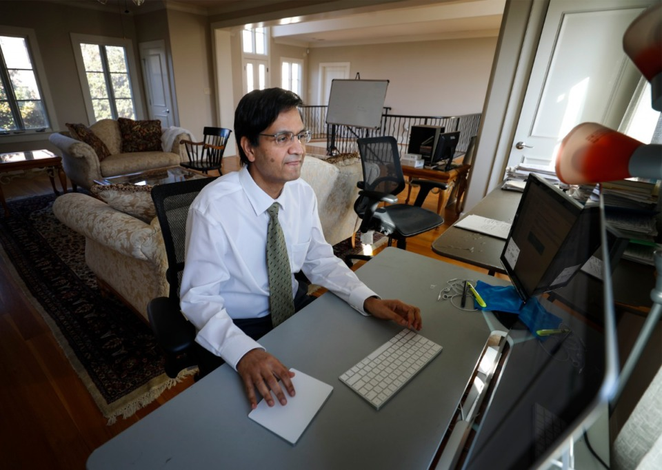 <strong>Dr. Manoj Jain answers emails in his home workspace on Wednesday, March 3, 2021.</strong> (Mark Weber/The Daily Memphian)