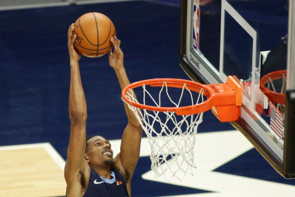 <strong>Memphis Grizzlies guard De'Anthony Melton attempts a dunk against the Minnesota Timberwolves during an NBA preseason basketball game on Dec. 12, 2020, in Minneapolis.</strong> (Andy Clayton- King/Associated Press file)
