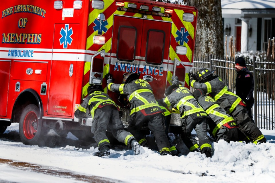 <strong>Memphis firefighters rescue an ambulance stuck in snow and ice on Walnut Grove Road on Tuesday, Feb. 16, 2021. Dan Conaway knows the man inside the ambulance.</strong>&nbsp;(Mark Weber/The Daily Memphian)