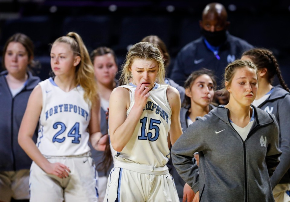 <strong>Northpoint Christian forward Briley Faith Cherry (middle) sheds tears with her teammates after falling to Providence Christian in their Division II Class A semifinals game on Thursday, March 4, 2021, in Cookeville</strong>. (Mark Weber/The Daily Memphian)