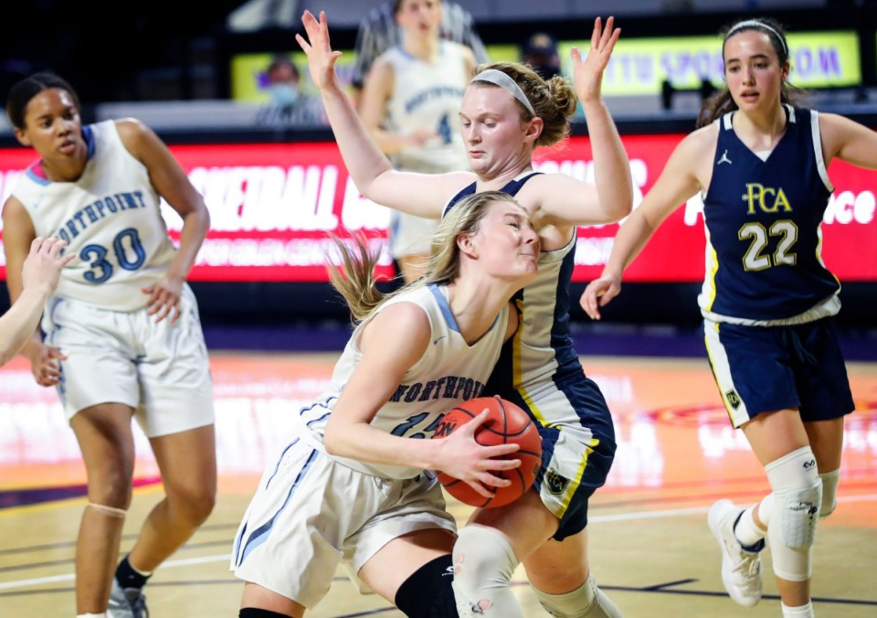 <strong>Northpoint Christian forward Briley Faith Cherry (front) drives the lane against Providence Christian defender A.C. Markham (right) during the Division II Class A semi-finals game on Thursday, March 4, 2021 in Cookeville.</strong> (Mark Weber/The Daily Memphian)