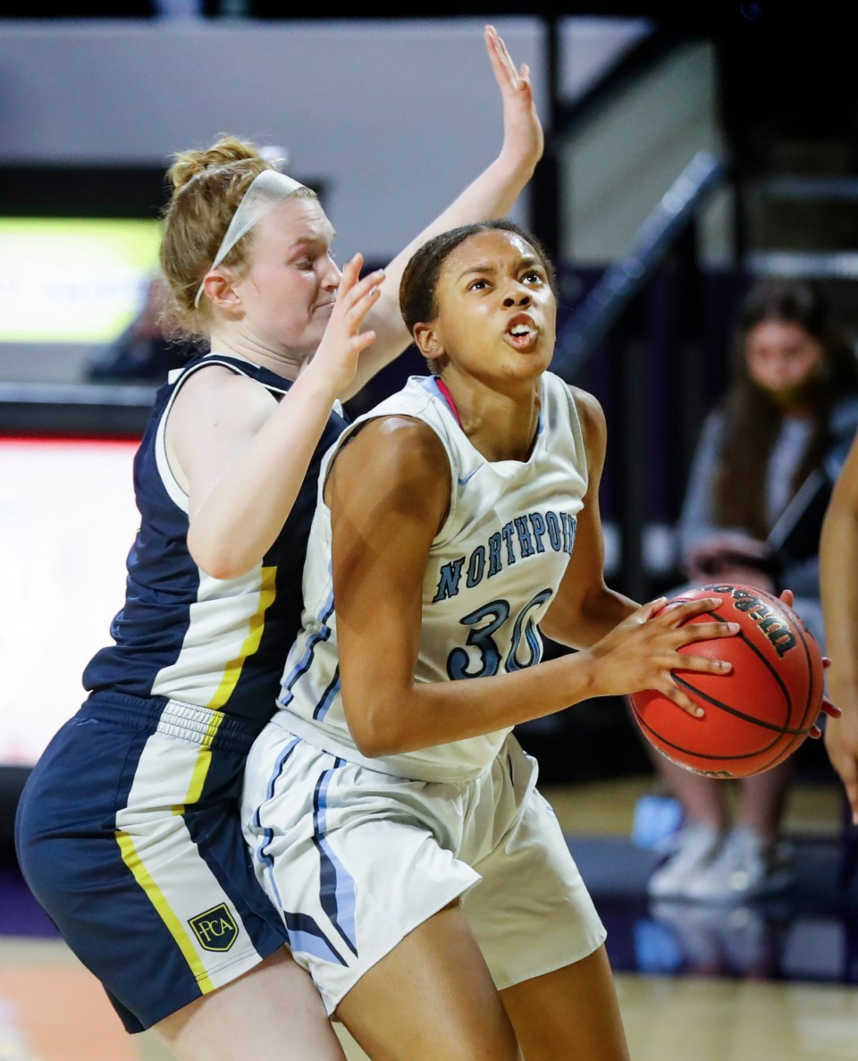 <strong>Northpoint Christian forward Leah Jones (right) drives to the basket against Providence Christian&rsquo;s A.C. Markham (left) in their 42-40 loss in the Division II Class A semifinals game on Thursday, March 4, 2021, in Cookeville. &ldquo;It was easy shots we could have made,&rdquo; she lamented.</strong> (Mark Weber/The Daily Memphian)