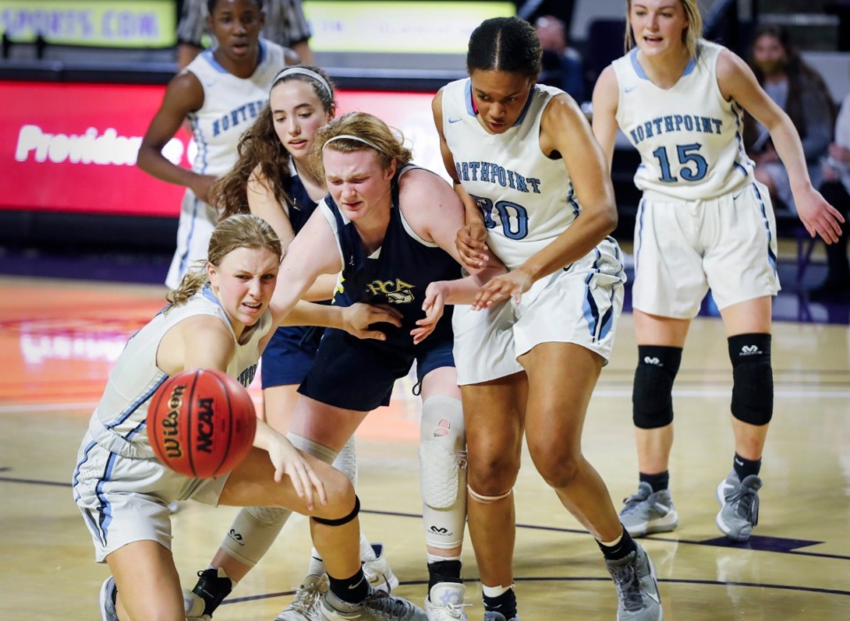 <strong>Northpoint Christian defenders Bethany Wright (left) and Leah Jones (second right) battle Providence Christian forward A.C. Markham (middle) for a loose ball during the Division II Class A semifinals game on Thursday, March 4, 2021, in Cookeville.</strong> (Mark Weber/The Daily Memphian)