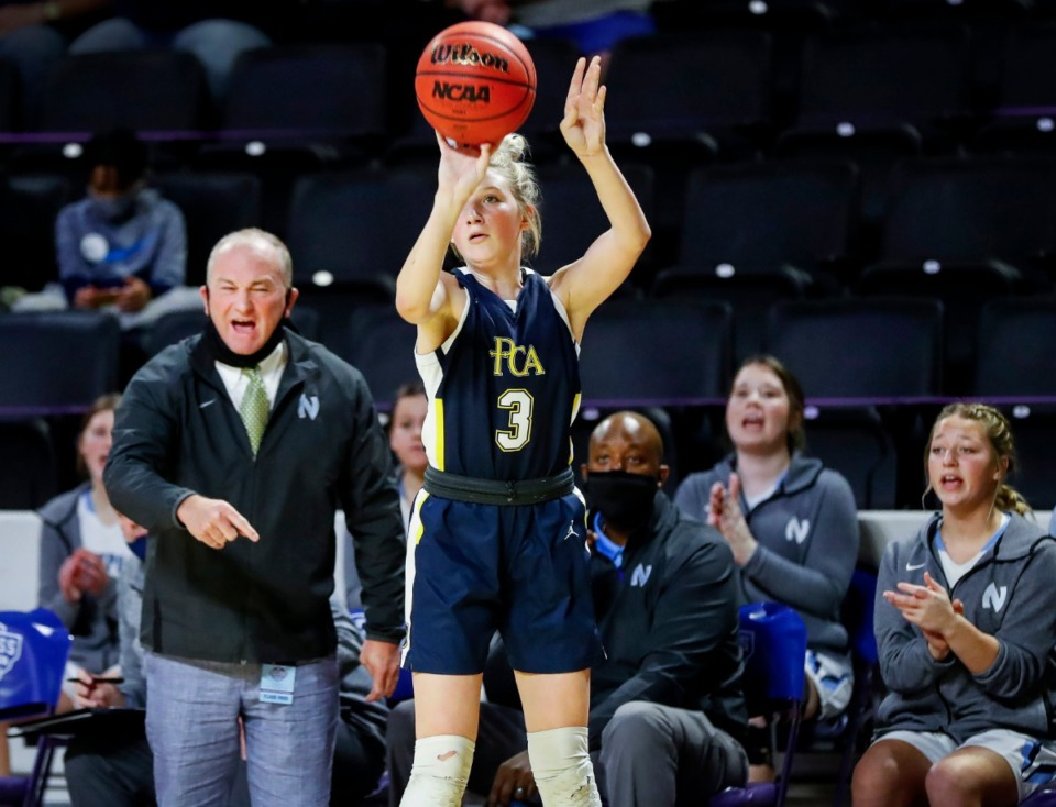 <strong>Northpoint Christian head coach Barry Gray (left) looks on as Providence Christian gaurd Alexandria Cox (right) takes a 3-point shot during action of the Division II Class A semifinals game on Thursday, March 4, 2021, in Cookeville.</strong> (Mark Weber/The Daily Memphian)