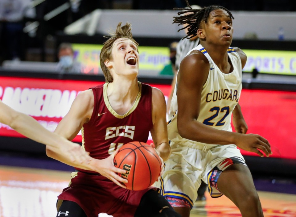 <strong>ECS guard Thomas Kizer (left) drives the lane against Goodpasture Christian defender Xavier Shegog (right) during the Division II Class A semifinals game on Thursday, March 4, 2021, in Cookeville.</strong> (Mark Weber/The Daily Memphian)