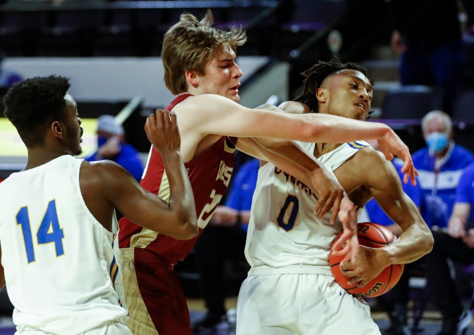 <strong>ECS forward William Webster (middle) battles Goodpasture Christian defenders Josh Williams (left) and Patrick Smith (right) for a rebound during the Division II Class A semifinals game on Thursday, March 4, 2021, in Cookeville.</strong> (Mark Weber/The Daily Memphian)