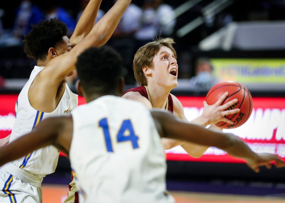 <strong>ECS guard Thomas Kizer (right) drives the lane against the Goodpasture Christian defense during the Division II Class A semifinals game on Thursday, March 4, 2021, in Cookeville.</strong> (Mark Weber/The Daily Memphian)
