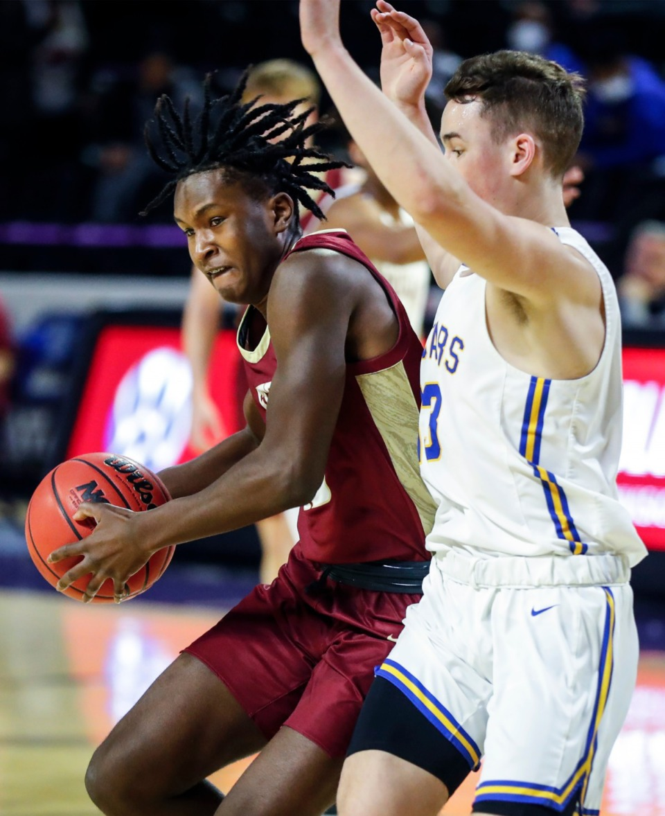<strong>ECS guard Marcellous Boyd (left) is fouled by Goodpasture Christian defender Chandler Woosley (right) during the Division II Class A semifinals game on Thursday, March 4, 2021, in Cookeville.</strong> (Mark Weber/The Daily Memphian)