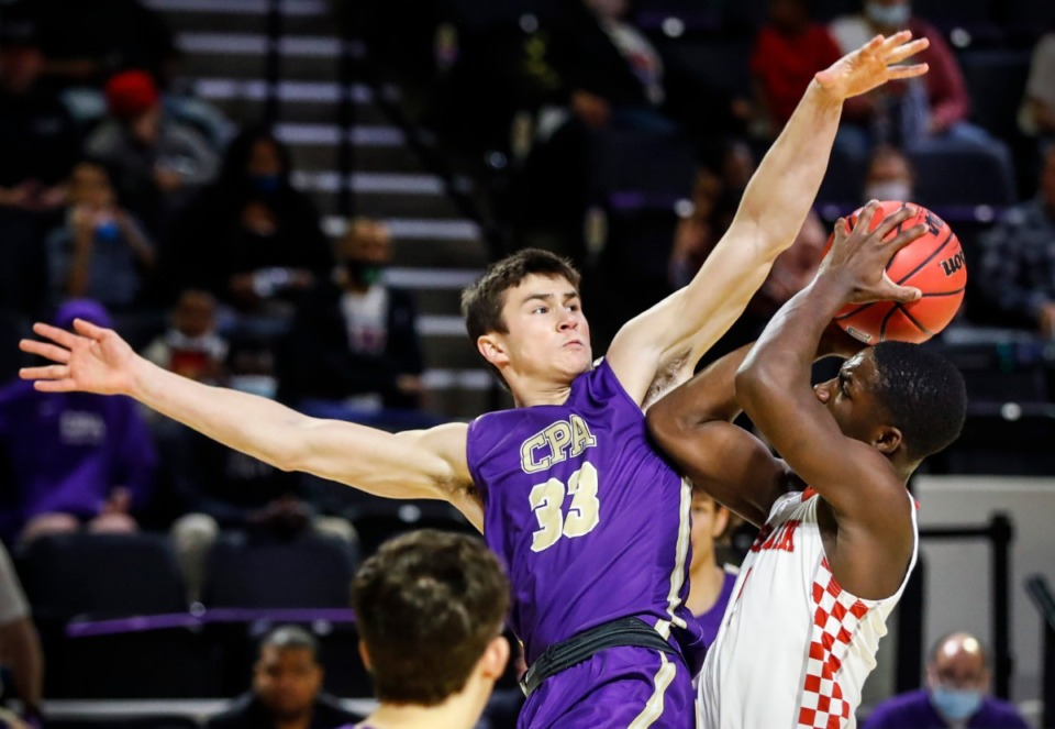 <strong>Christ Presbyterian&rsquo;s Sam Smith (left) tries to block Tipton-Rosemark guard Cameron Donegan (right) during the Division II Class A semifinals game on Thursday, March 4, 2021, in Cookeville.</strong> (Mark Weber/The Daily Memphian)