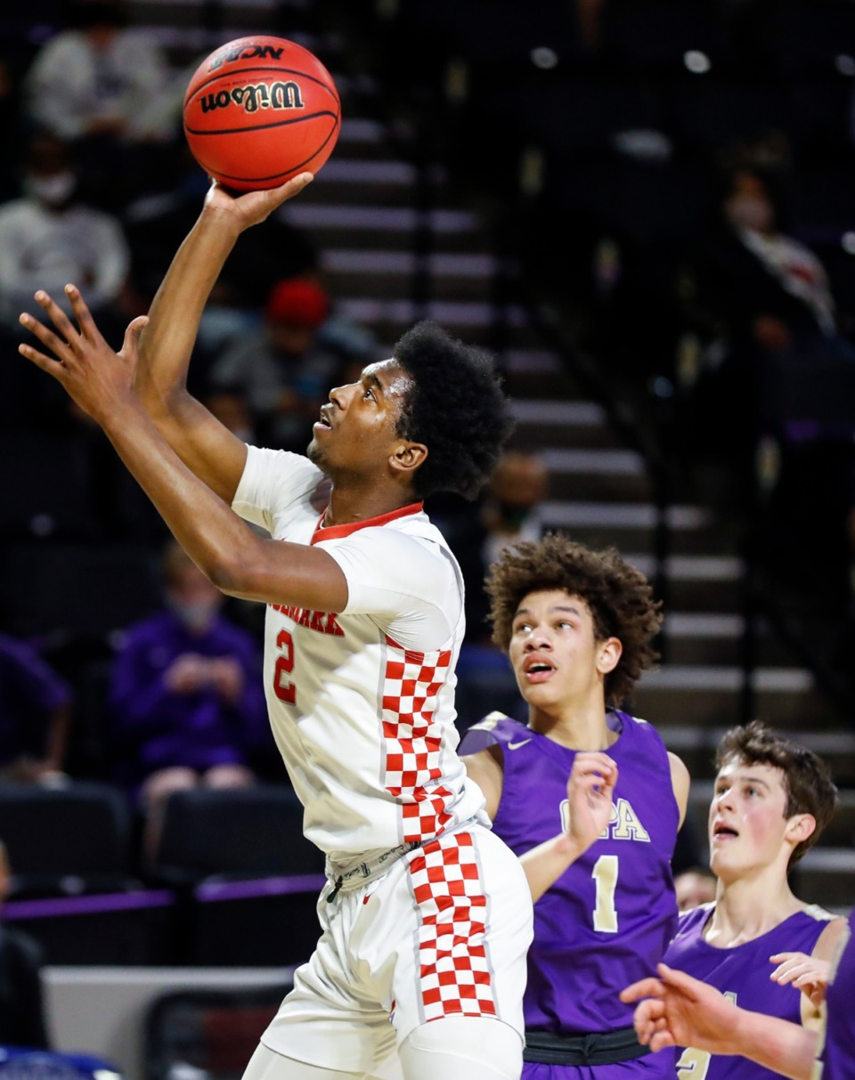 <strong>Tipton-Rosemark forward Alex Anderson (left) hits a running jumper against Christ Presbyterian&rsquo;s Jordan Dewalt (right) during the Division II Class A semifinals game on Thursday, March 4, 2021, in Cookeville.</strong> (Mark Weber/The Daily Memphian)
