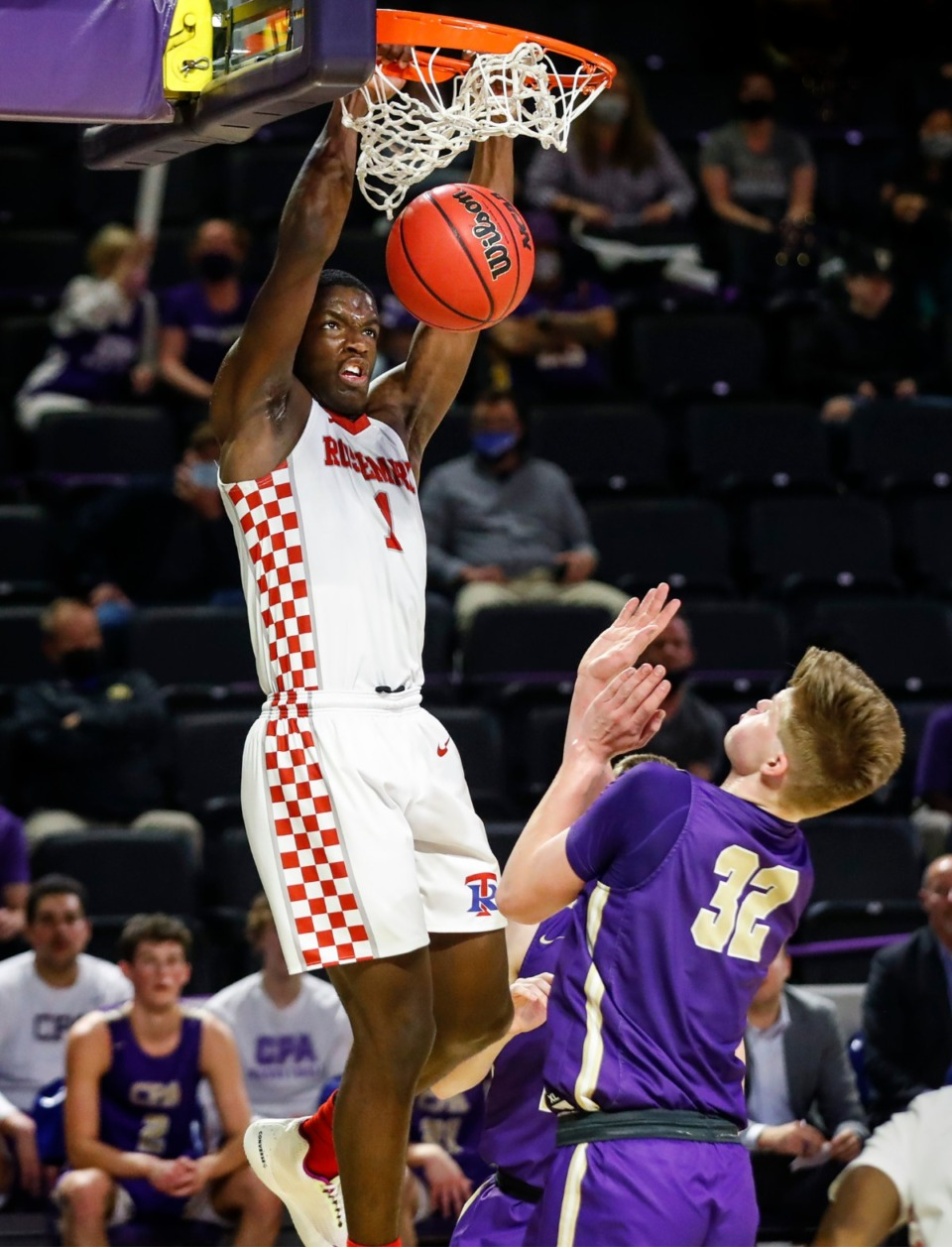<strong>Tipton-Rosemark guard Tyler Byrd (left) dunks over Christ Presbyterian&rsquo;s Braeden Moore (right) during the Division II Class A semifinals game on Thursday, March 4, 2021, in Cookeville.</strong> (Mark Weber/The Daily Memphian)