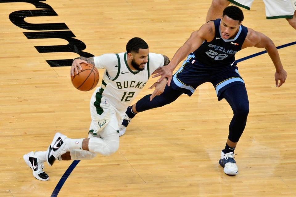 <strong>Grizzlies guard Desmond Bane (22) tries to block Milwaukee Bucks guard D.J. Augustin (12)</strong>&nbsp;<strong>on March 4 at FedExForum.</strong> (Brandon Dill/AP)