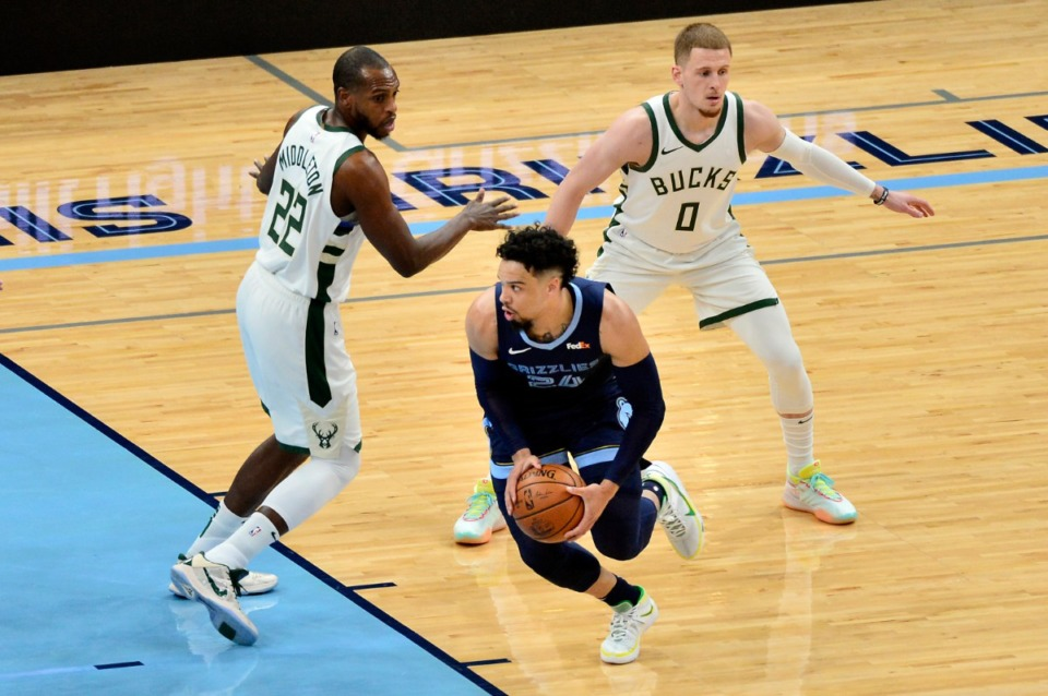 <strong>Grizzlies guard Dillon Brooks (24) dribbles past Milwaukee Bucks forward Khris Middleton (22) and guard Donte DiVincenzo (0)</strong>&nbsp;<strong>on March 4 at FedExForum.</strong> (Brandon Dill/AP)
