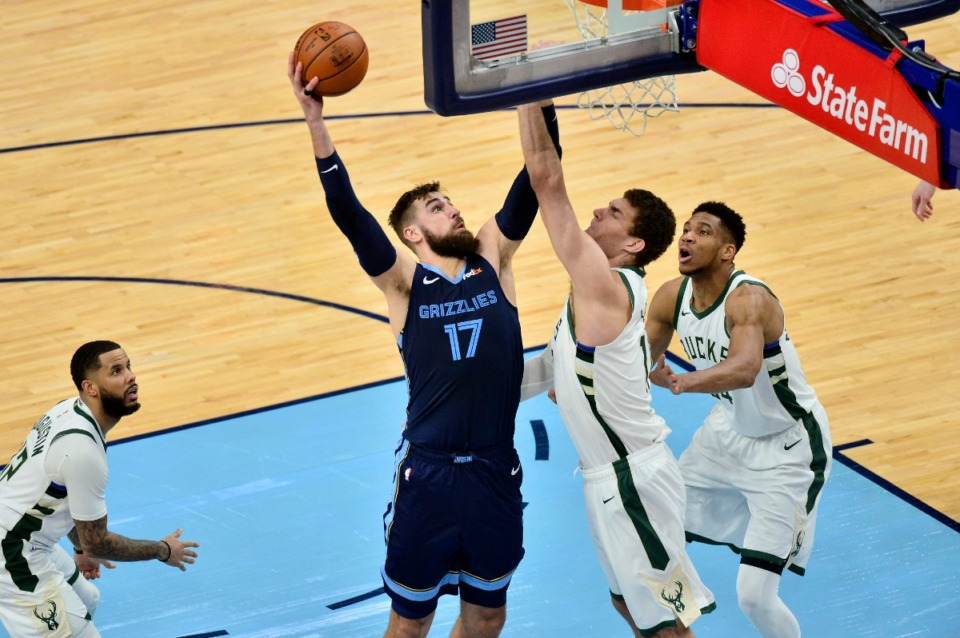 <strong>Grizzlies center Jonas Valanciunas (17) shoots against Milwaukee Bucks center Brook Lopez on March 4 at FedExForum.</strong> (Brandon Dill/AP)