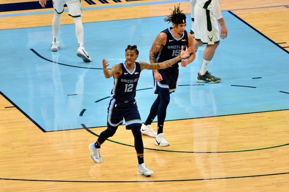 <strong>Memphis Grizzlies guard Ja Morant (12) signals to his team during the against Milwaukee&nbsp;on March 4 at FedExForum. (Brandon Dill/AP)</strong>