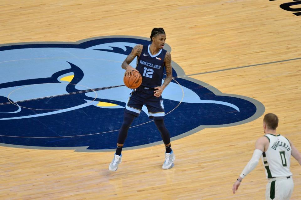 <strong>Memphis Grizzlies guard Ja Morant (12) calls a play against the Milwaukee Bucks&nbsp;on March 4 at FedExForum.</strong> (Brandon Dill/AP)