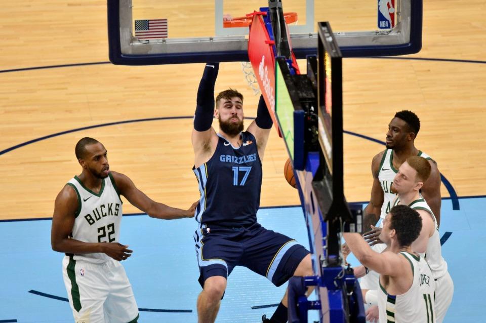 <strong>Grizzlies center Jonas Valanciunas (17) dunks the ball against the Milwaukee Bucks</strong> <strong>on March 4 at FedExForum.</strong> (Brandon Dill/AP)