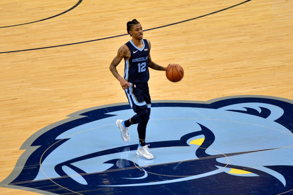 <strong>Grizzlies guard Ja Morant (12) brings the ball upcourt against the Milwaukee Bucks</strong>&nbsp;<strong>on March 4 at FedExForum.</strong> (Brandon Dill/AP)