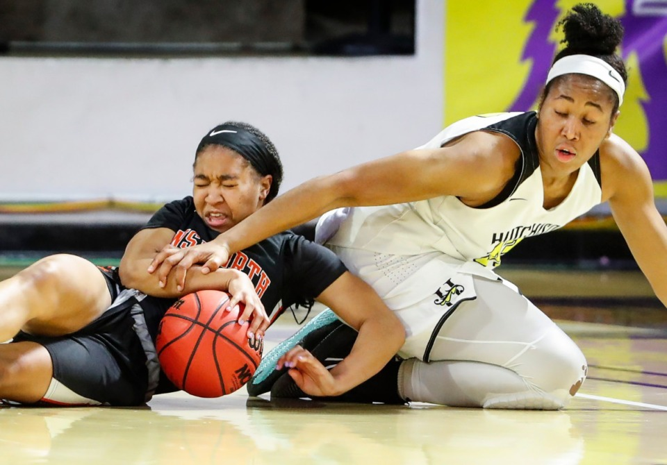 <strong>Hutchison defender and Miss Basketball finalist Carmyn Harrison (right) battles Ensworth guard Jayda Woods (left) for a loose ball during action of the Division II Class AA semi-finals game on Friday, March 5, 2021 in Cookeville.</strong> (Mark Weber/The Daily Memphian)