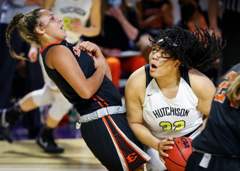 <strong>Hutchison forward Kaia Barnett (right) drives the lane against Ensworth defender Kamil Collier (left) during action of the Division II Class AA semi-finals game on Friday, March 5, 2021 in Cookeville.</strong> (Mark Weber/The Daily Memphian)