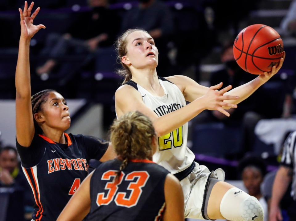 <strong>Hutchison guard Maxine Engel (right) drives for a layup against the Ensworth defense during action of the Division II Class AA semi-finals game on Friday, March 5, 2021 in Cookeville.</strong> (Mark Weber/The Daily Memphian)