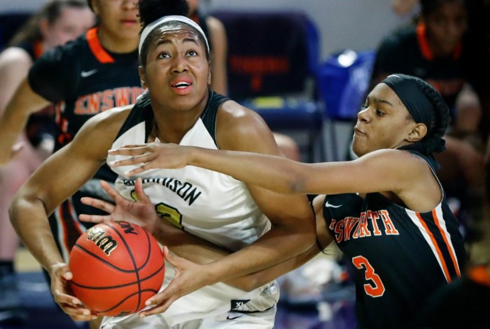 <strong>Hutchison forward Carmyn Harrison (left) drives the lane against Ensworth defender Deayonna Cambridge (right) during action of the Division II Class AA semi-finals game on Friday, March 5, 2021 in Cookeville.</strong> (Mark Weber/The Daily Memphian)