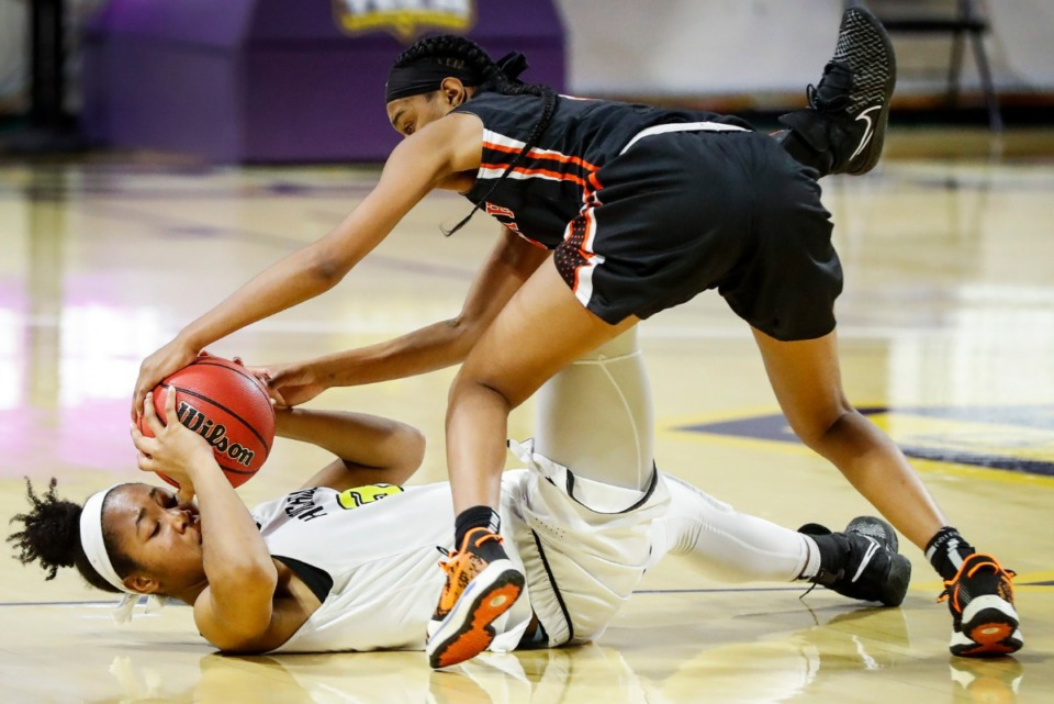 <strong>Hutchison forward Carmyn Harrison (left) battles Ensworth defender Deayonna Cambridge (right) for a loose ball during action of the Division II Class AA semi-finals game on Friday, March 5, 2021 in Cookeville.</strong> (Mark Weber/The Daily Memphian)