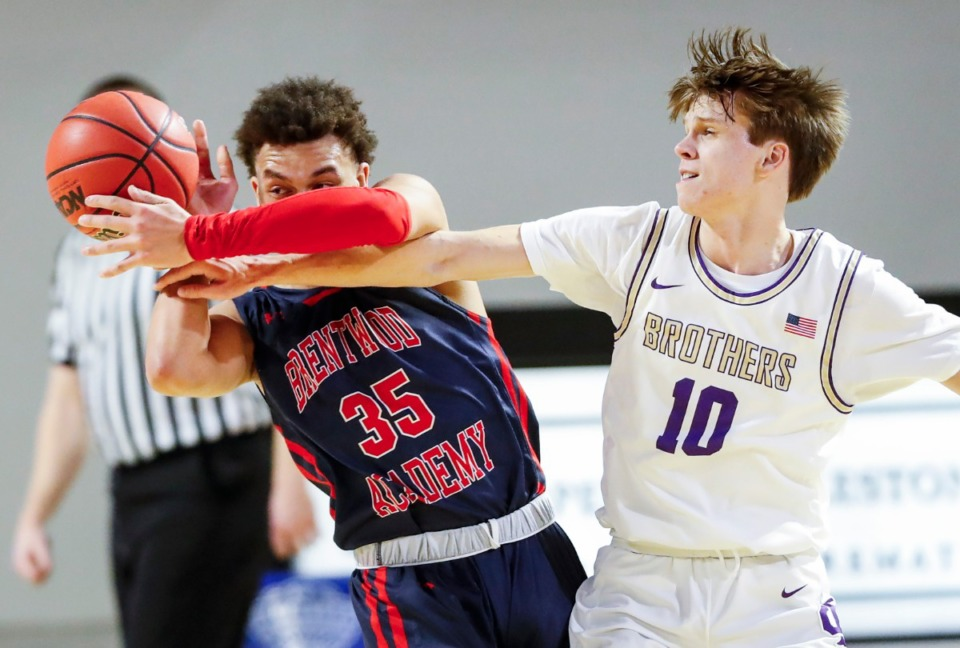 <strong>CBHS defender Harrison Kelly (right) battles Brentwood Academy forward DJ Senter (left0 for a loose ball in the Division II Class AA semifinals game on Friday, March 5, 2021, in Cookeville.</strong> (Mark Weber/The Daily Memphian)
