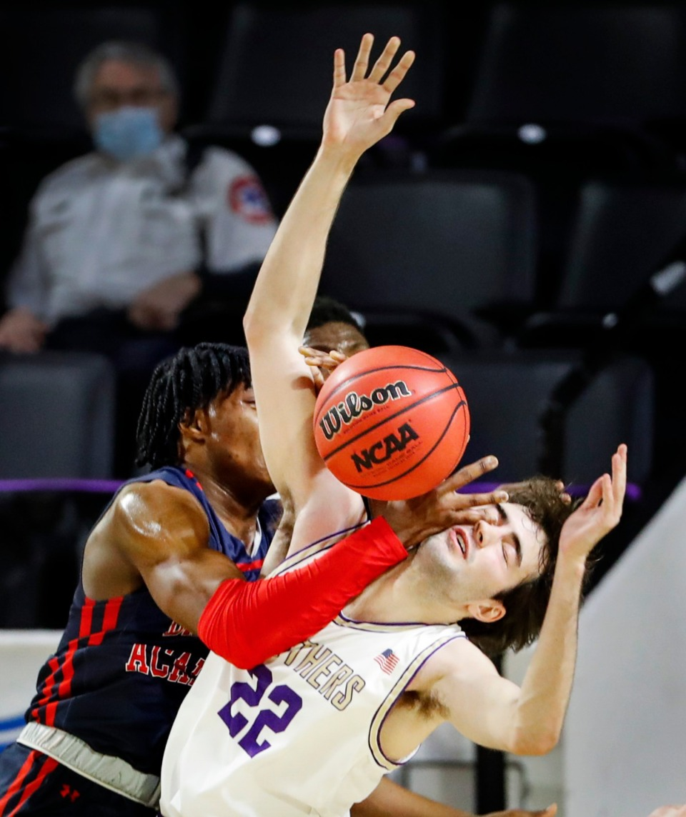 <strong>CBHS defender Colin Scifres (right) takes a hand to the face while battling Brentwood Academy forward Caleb Brooks (left) for a rebound in the Division II Class AA semifinals game on Friday, March 5, 2021, in Cookeville.</strong> (Mark Weber/The Daily Memphian)