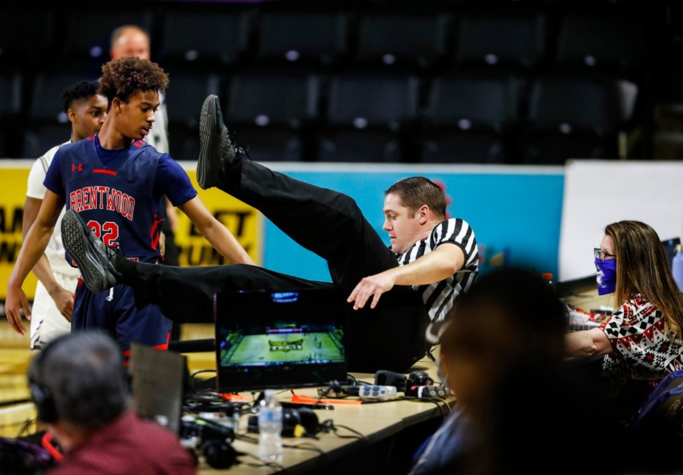 <strong>An official falls into the press row in the Division II Class AA semifinals game between CBHS and Brentwood Academy on Friday, March 5, 2021, in Cookeville.</strong> (Mark Weber/The Daily Memphian)