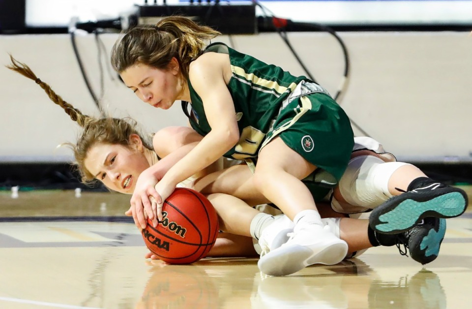 <strong>Hutchison defender Maddie Prather (left) battles Knoxville Catholic guard Grayce Lane (right) for a loose ball during action of the Division II Class AA finals game on Saturday, March 6, 2021 in Cookeville. (</strong>Mark Weber/The Daily Memphian)