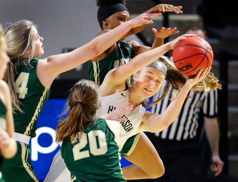 <strong>Hutchison guard Berklee Scifres (right) grabs a rebound away from Knoxville Catholic players during action of the Division II Class AA finals game on Saturday, March 6, 2021 in Cookeville.</strong> (Mark Weber/The Daily Memphian)