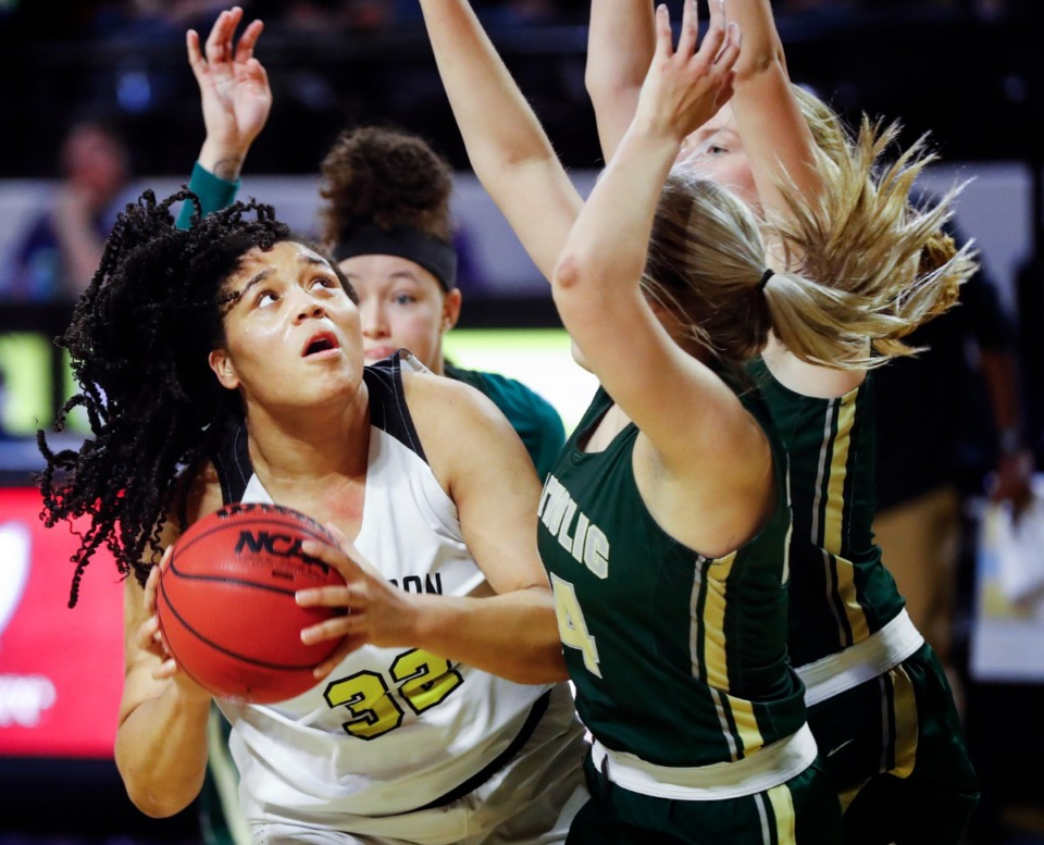 <strong>Hutchison forward Kaia Barnett (left) drives for a layup against the Knoxville Catholic defense during action of the Division II Class AA finals game on Saturday, March 6, 2021 in Cookeville.</strong> (Mark Weber/The Daily Memphian)