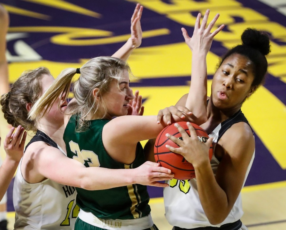 <strong>Hutchison forward Carmyn Harrison (right) grabs a rebound away from Knoxville Catholic defender Ella Renfree (left) during action of the Division II Class AA finals game on Saturday, March 6, 2021 in Cookeville.</strong> (Mark Weber/The Daily Memphian)