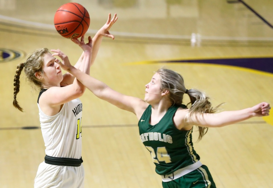 <strong>Hutchison guard Maddie Prather (left) puts up a 3-point shot against Knoxville Catholic defender Sydney Mains (right) during action of the Division II Class AA finals game on Saturday, March 6, 2021 in Cookeville.</strong> (Mark Weber/The Daily Memphian)
