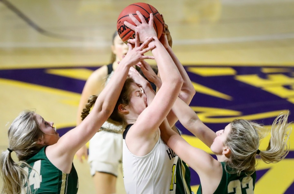 <strong>Hutchison forward Maddie Prather (middle) takes a shot to the face while battling Knoxville Catholic defenders Sydney Mains (left) and Ella Renfree (right) for a loose ball during action of the Division II Class AA finals game on Saturday, March 6, 2021 in Cookeville.</strong> (Mark Weber/The Daily Memphian)