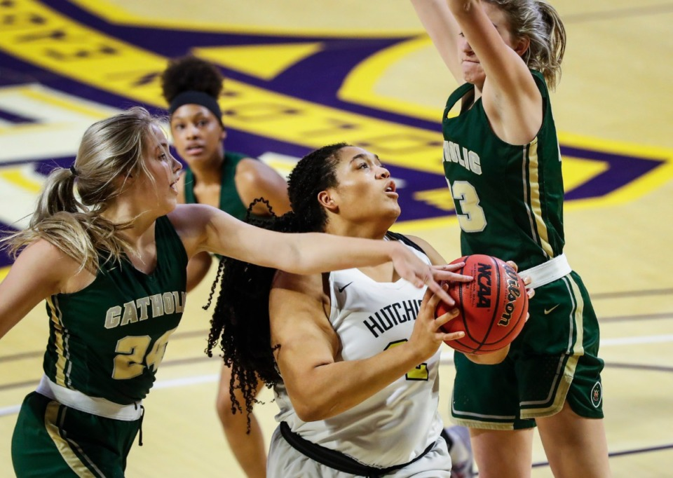 <strong>Hutchison forward Kaia Barnett (middle) drives the lane against the Knoxville Catholic defense during action of the Division II Class AA finals game on Saturday, March 6, 2021 in Cookeville.</strong> (Mark Weber/The Daily Memphian)