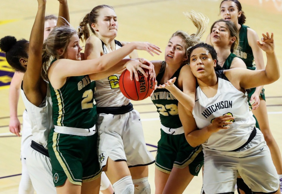 <strong>Hutchison forward Kaia Barnett (right) looks on as teammates Maxine Engel (second left) battles for a rebound against Knoxville Catholic during action of the Division II Class AA finals game on Saturday, March 6, 2021 in Cookeville.</strong> (Mark Weber/The Daily Memphian)