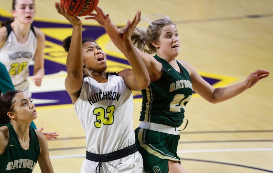 <strong>Hutchison forward Carmyn Harrison (left) drives for a layup against Knoxville Catholic defender Sydney Mains (right) during action of the Division II Class AA finals game on Saturday, March 6, 2021 in Cookeville.</strong> (Mark Weber/The Daily Memphian)