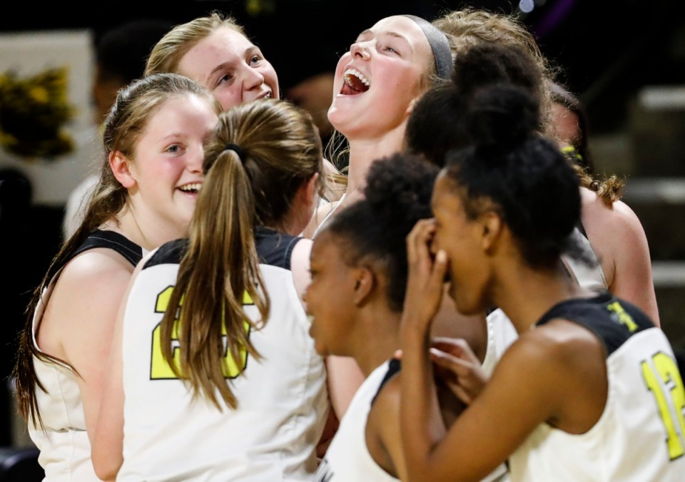<strong>Hutchison guard Berklee Scifres (middle) celebrates with her teammates after defeating Knoxville Catholic 41-34 during action of the Division II Class AA finals game on Saturday, March 6, 2021 in Cookeville.</strong> (Mark Weber/The Daily Memphian)