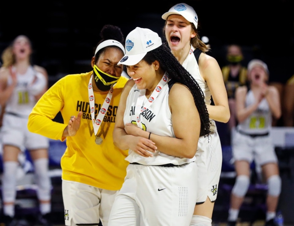 <strong>Hutchison senior Kaia Barnett (middle) celebrates with teammates Carmyn Harrison (left) and Maxine Engel (right) after being named Division II Class AA finals game MVP on Saturday, March 6, 2021 in Cookeville.</strong> (Mark Weber/The Daily Memphian)