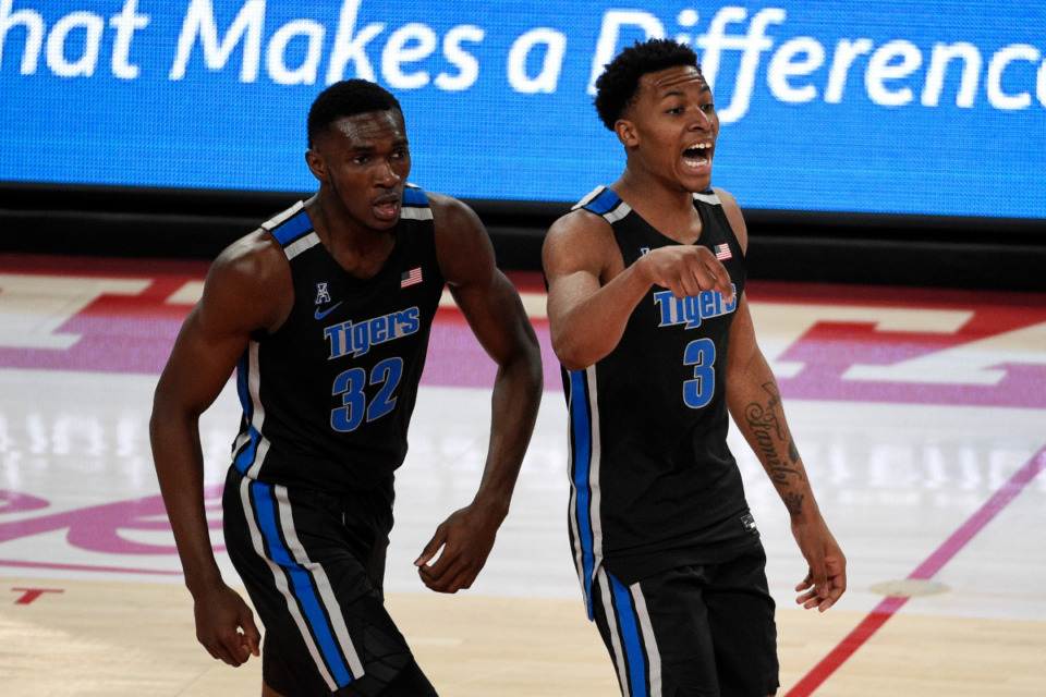 <strong>Memphis guard Landers Nolley II (3) reacts after making a three point basket as Moussa Cisse (32) watches during the first half of an NCAA college basketball game against Houston, Sunday, March 7, 2021, in Houston.</strong> (AP Photo/Eric Christian Smith)