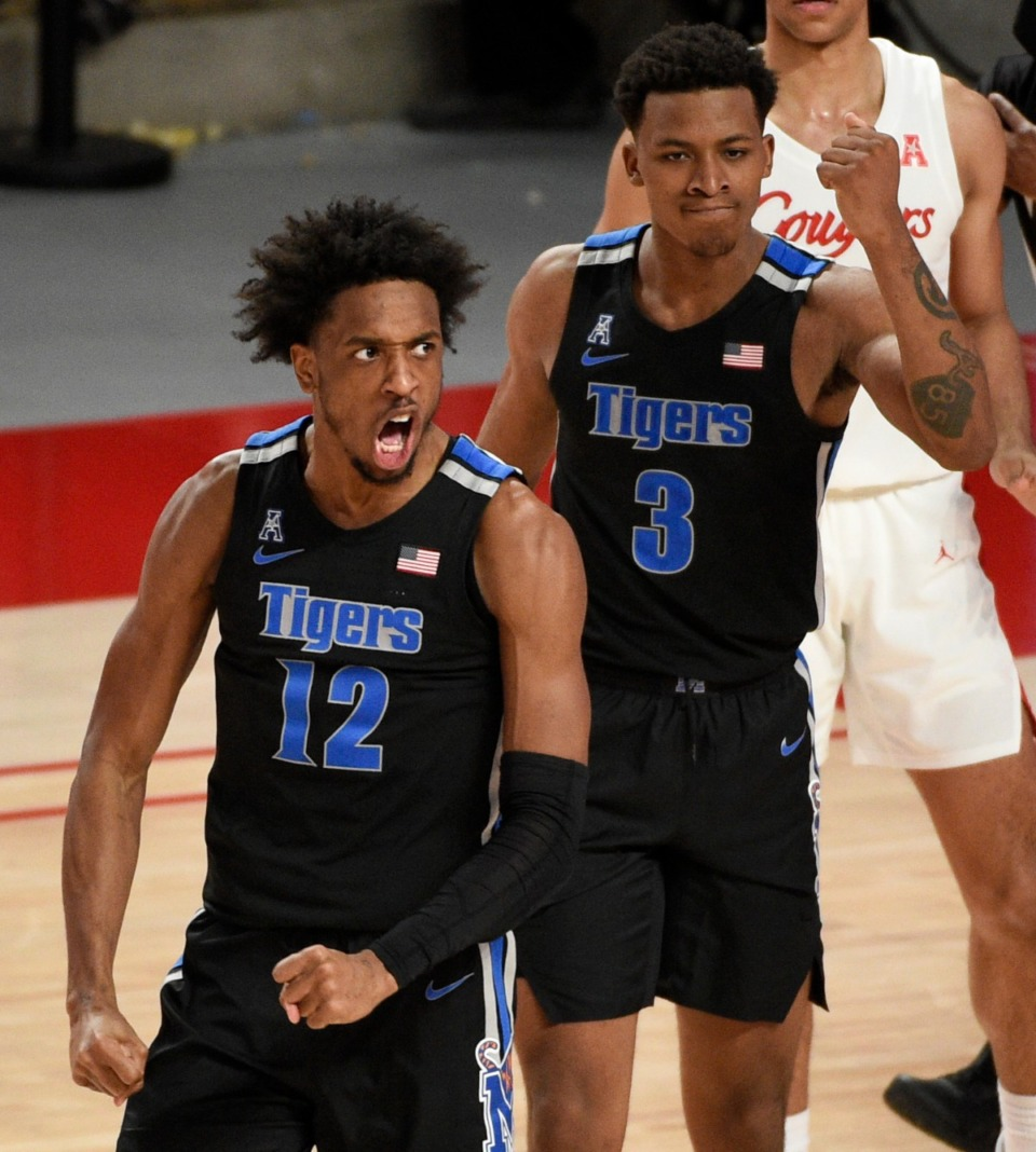 <strong>Memphis forward DeAndre Williams (12) reacts after drawing a foul during the second half of an NCAA college basketball game against Houston, Sunday, March 7, 2021, in Houston.</strong> (Eric Christian Smith/AP)
