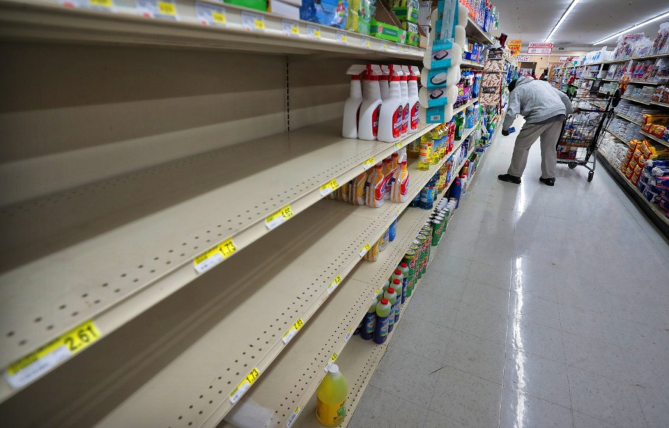 <strong>Shoppers look for cleaning supplies during a busy day at the CashSaver in Midtown on March, 12, 2020, where there were shortages on cleaning wipes and disinfectant as customers fearful of COVID-19 tried to stock up.</strong> (Jim Weber/Daily Memphian file)