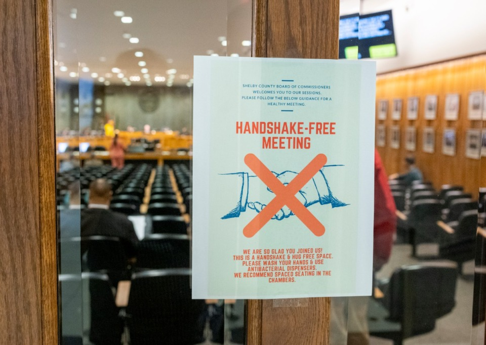 <strong>A notice is posted at the door for a handshake-free Shelby County Commission meeting Wednesday, March 18, 2020.</strong> (Greg Campbell/Special to The Daily Memphian).