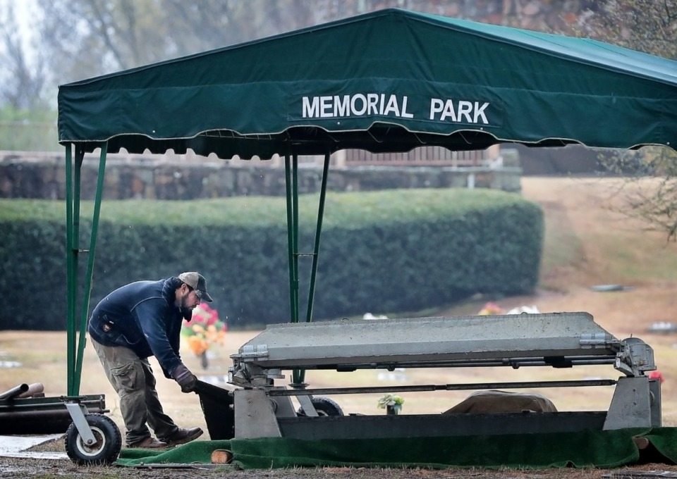 <strong>A burial site is prepared for a funeral at Memorial Park Cemetery on March 18, 2020. In keeping with new guidelines, chairs are spaced apart to keep mourners properly distanced from each other.</strong> (Jim Weber/Daily Memphian file)