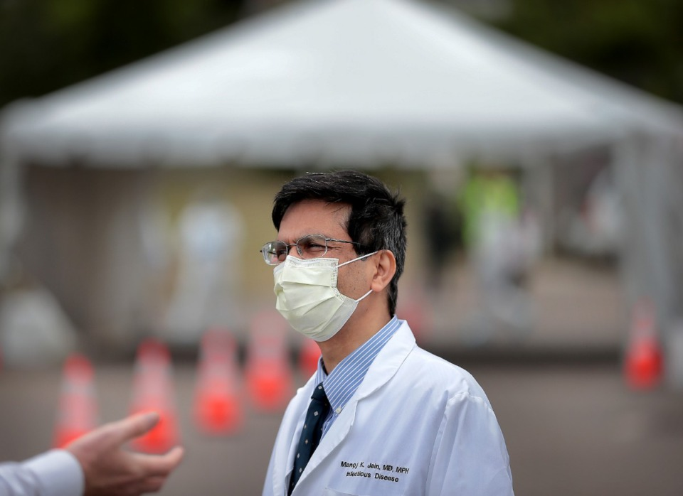 <strong>Infectious disease expert Dr. Manoj Jain (shown at a COVID-19 testing site on April 25, 2020) says he visited family over the weekend after being socially distant for a year. &ldquo;We have to show people the benefits of vaccination. If people don&rsquo;t experience and realize the benefits of vaccination, they will be reluctant to get vaccinated.&rdquo; </strong>(Jim Weber/Daily Memphian file)