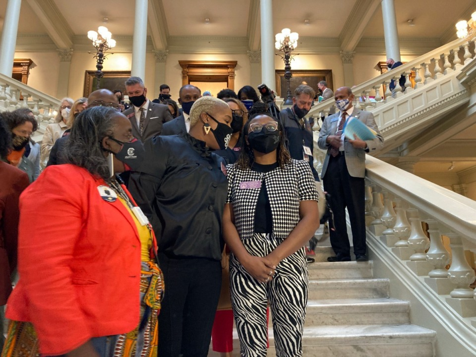 <strong>Absentee voting is under fire from Republicans across the country. In this Friday, Feb. 26, 2021, file photo, Georgia House Democrats speak with Democratic Rep. Park Cannon, right, in Atlanta during a sit-in at the state capitol sparked by opposition to Republican proposals that would restrict voting.&nbsp;</strong>(Jeff Amy/AP file)