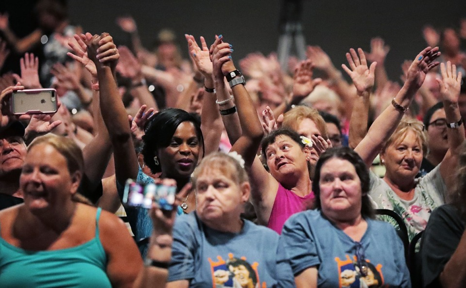 <strong>A crowd of die-hard fans sing along as Elvis Presley tribute artist Dean Zeligman performs at the Graceland Exhibition Center in the pre-COVID days of August 2019.</strong> (Jim Weber/Daily Memphian)