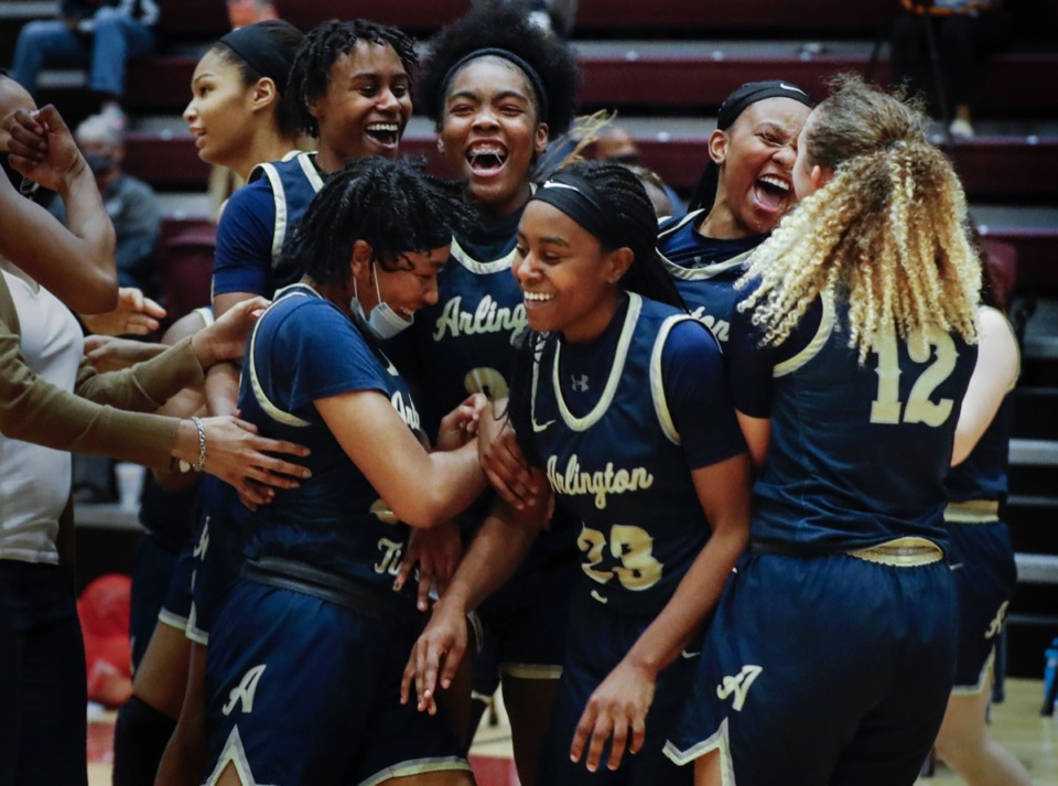 <strong>Arlington teammates celebrate a 47-43 victory over Collierville on Monday, March 8, 2021.</strong> (Mark Weber/The Daily Memphian)